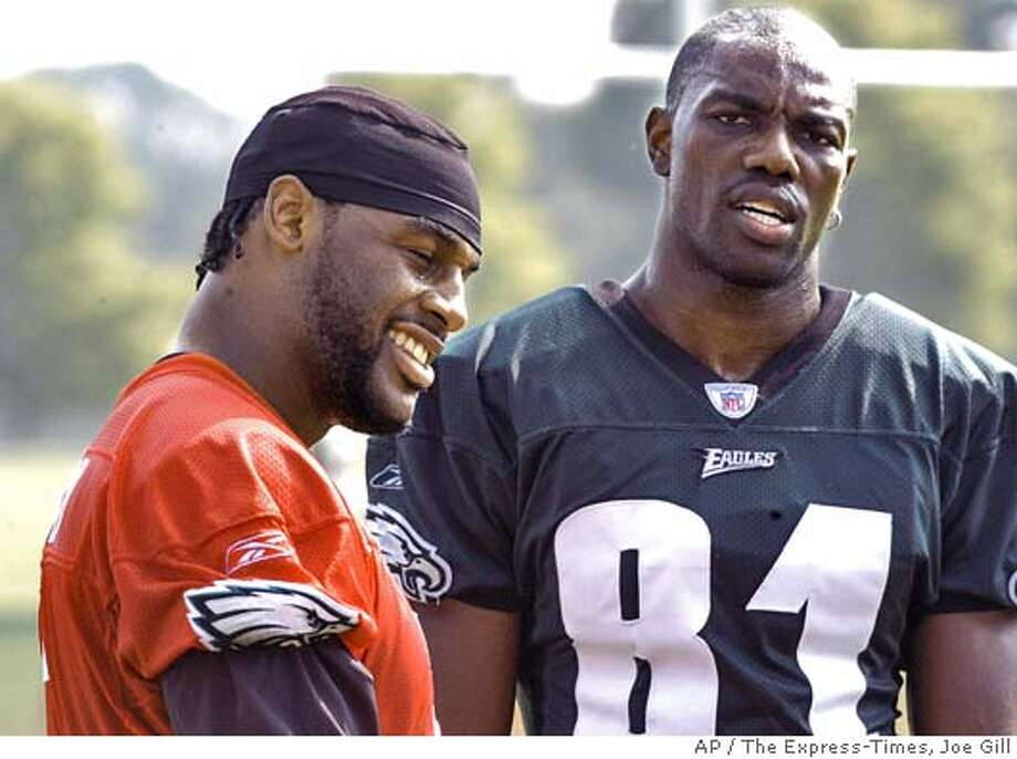 Philadelphia Eagles quarterback Donovan McNabb, left, and wide receiver Terrell Owens, right, take a break during afternoon drills at Eagles training camp at Lehigh University in Bethlehem, PA, Monday , August 2, 2004. Owens, an off season free agent acquisition by the Eagles , projected to be McNabb`s primary receiver for the upcoming season ,missed a portion of the afternoon practice to be treated for getting overheated (AP Photo/The Express-Times, Joe Gill) Photo: JOE GILL