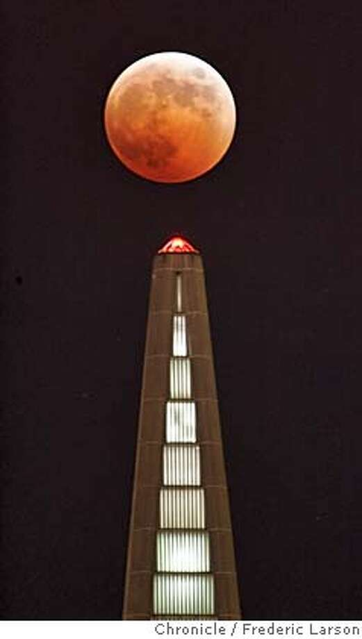 ECLIPSE_050_fl.jpg �A full eclipse of the moon, like an evil pumpkin, tops San Francisco Transamerica Pyramid Wednesday evening 10/27. The partial phase of the eclipse started 6:14 p.m., just as the full moon is rising from the east bay hills. Totality began at 7:23 p.m., when the moon, blood- red was tucked completely within Earth's shadow. The next total eclipse in the Bay Area can be viewed in the wee hours of the night August 28, 2007. 10/27/04 San Francisco CA Frederic Larson The San Francisco Chronicle Nation#MainNews#Chronicle#10/28/2004#ALL#5star##0422436236 Photo: Frederic Larson