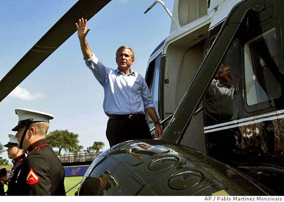 President Bush waves from the top step of Marine One helicopter as he leaves a campaign rally at Space Coast Stadium Saturday, Oct. 23, 2004 in Melbourne, Fla. (AP Photo/Pablo Martinez Monsivais) Photo: PABLO MARTINEZ MONSIVAIS