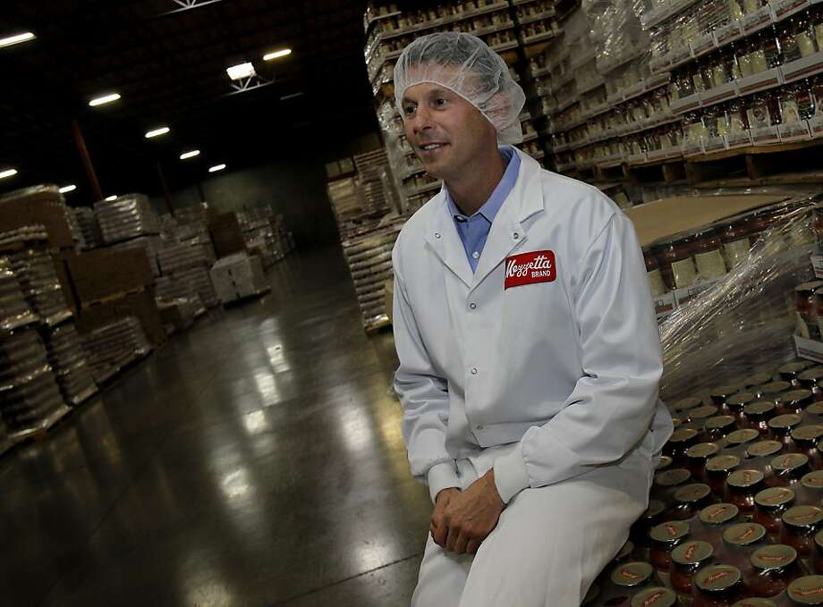 Jeff Mezzetta sits on jars of his new Napa Valley brand pasta sauce. Mezzetta Brand foods in American Caynon, Calif. is expanding their food choices and going nationwide with sandwich spreads and upscale pasta sauces with Napa Valley wine in their ingredients. Photo: Brant Ward, The Chronicle