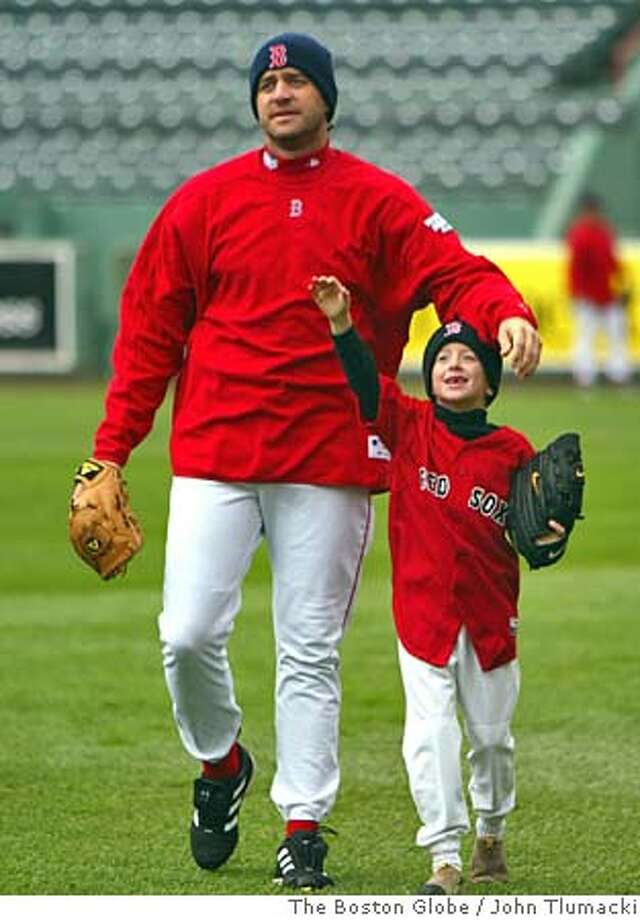 (NYT16) BOSTON -- Oct. 22, 2004 -- BBO-WORLD-SERIES-2 -- Boston Red Sox pitcher Mike Meyers walks with his son, Daryl, 7, in the outfield at Fenway Park, Friday, Oct. 22, 2004 after his son took some catches with him during practice. The Red Sox and St. Louis Cardinals play Game 1 of the World Series Saturday evening. (John Tlumacki/The Boston Globe) XNYZ Sports#Sports#Chronicle#10/23/2004#ALL#5star##0422427092 Photo: John Tlumacki