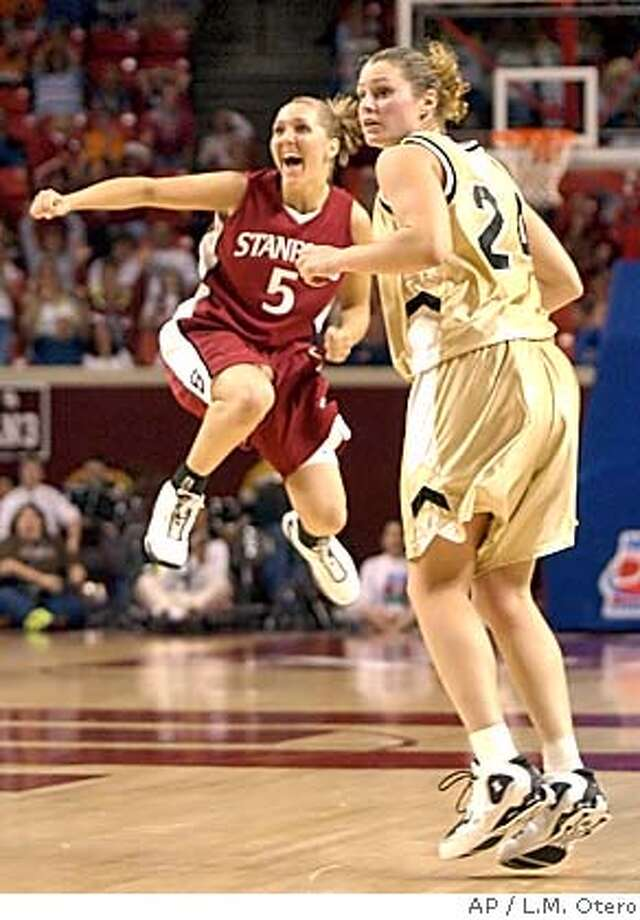 Stanford guard Kelley Suminski (5) reacts to her game winning three-point shot as Vanderbilt guard Hillary Hager (24) looks on at the NCAA Midwest Regional in Norman, Okla., Sunday, March 28, 2004. (AP Photo/L.M. Otero) Stanford's Kelley Suminski seems to be walking on air after her 3-pointer knocked off Hillary Hager and Vanderbilt. Suminski had an open look at the hoop as she accepted Nicole Powell's pass, and cashed in. Sports#Sports#Chronicle#10/27/2004#ALL#5star##0421697426 Photo: L.M. OTERO
