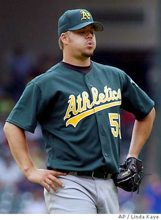 Oakland Athletics pitcher Joe Blanton reacts after giving up a single to Texas Rangers' Richard Hidalgo in the seventh inning, Tuesday, April 19, 2005, in Arlington, Texas. Blanton pitched 6 2-3 innings, giving up five hits and two runs in the 3-0 loss to the Rangers. (AP Photo/Linda Kaye) Photo: LINDA KAYE
