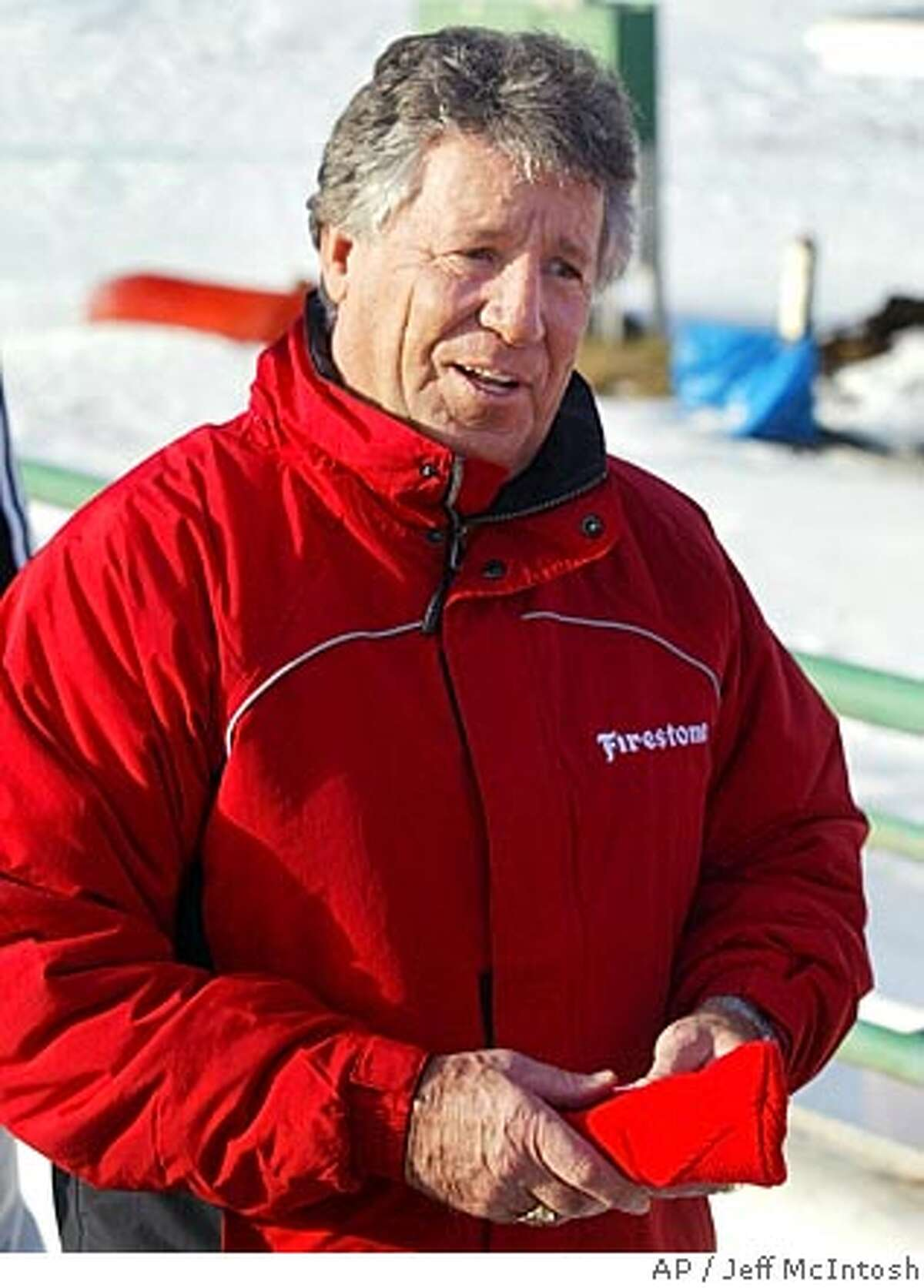 Former race car driver Mario Andretti smiles after riding a bobsled in Calgary, Wednesday, Jan. 19, 2005. Andretti was in the city promoting tires and wanted to try boblsedding. (AP Photo/Jeff McIntosh) Ran on: 01-29-2005 Mario Andretti was out for blood at Infineon Raceway on Friday, and he got it.