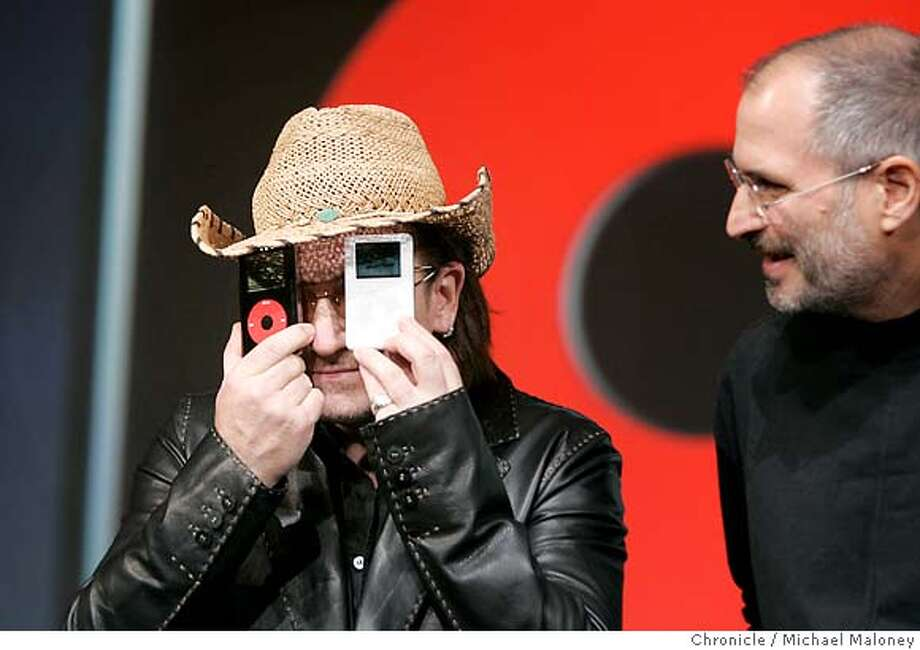 APPLE27_145_MJM.jpg  After the press conference and during a photo op, Bono displays the new iPods as Steve Jobs looks on.  Apple Computer unveiled a color screen version of its popular iPod music player in addition to a black and red special addition version in partnership with the rock band U2. At a press conference in San Jose, Apple CEO Steve Jobs showed off both versions of the iPod and Bono and The Edge of U2 performed 2 new songs from their upcoming album.  Photo by Michael Maloney / San Francisco Chronicle Photo: Michael Maloney