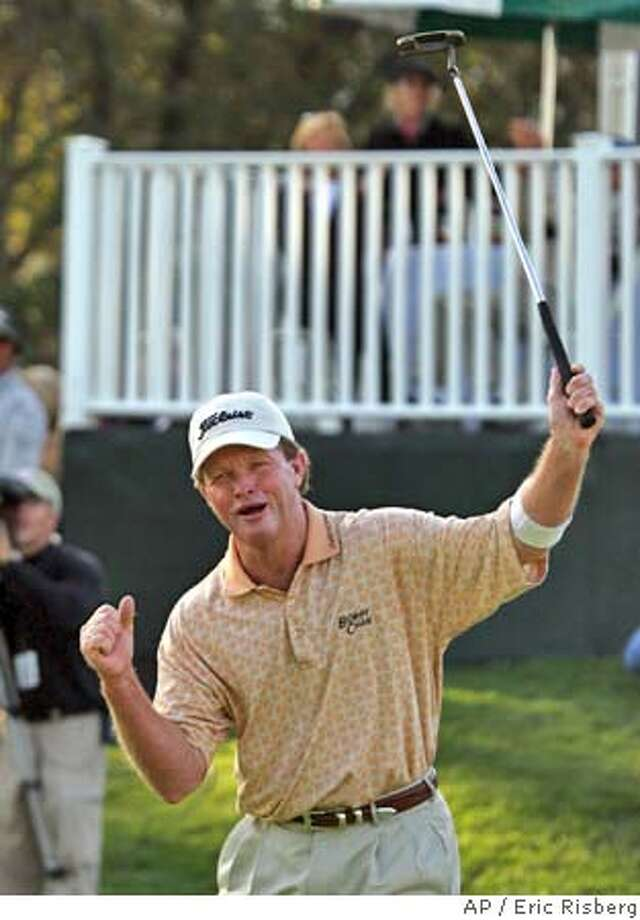 Tom Kite reacts after making a birdie on the 18th green of the Sonoma Golf Club during the second round of the Charles Schwab Cup Championship in Sonoma, Calif., Friday, Oct. 22, 2004. Kite, the second round leader, shot a 2-under-par 70 to finish at total 10-under-par.(AP Photo/Eric Risberg) Sports#Sports#Chronicle#10/23/2004#ALL#5star##0422427374 Photo: ERIC RISBERG