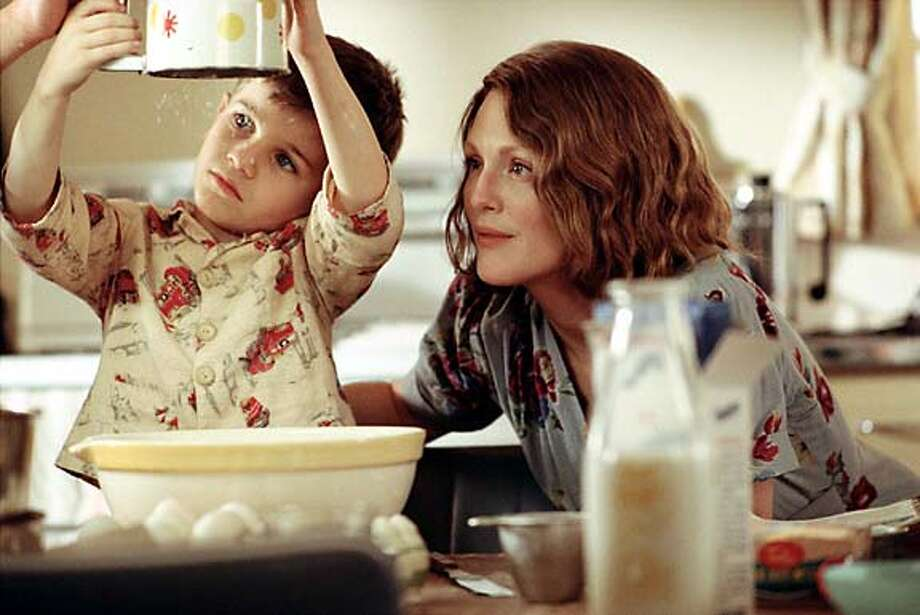 "Julianne Moore (with Jack Rovello) struggles to get through the day in ""The Hours."""