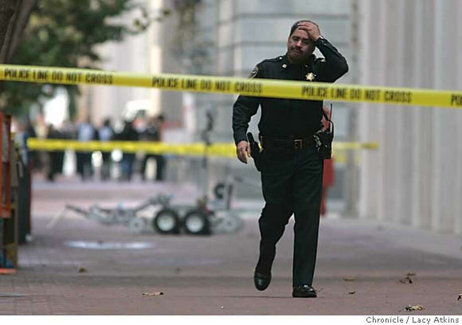 San Francisco Police Capt. James Dudley walks away from the robot carrying what they thought was a bomb in front of 380 Market Street, Monday Oct.25, 2004. It turned out to be must frustating for the police and the city. San Francisco Police, Fire and Swat teams respond to a bomb scare at Front and Market Street in San Francisco, Oct.25,2004. LACY ATKINS/SAN FRANCISCO CHRONICLE Metro#Metro#Chronicle#10/26/2004#ALL#5star##0422432107 Photo: LACY ATKINS
