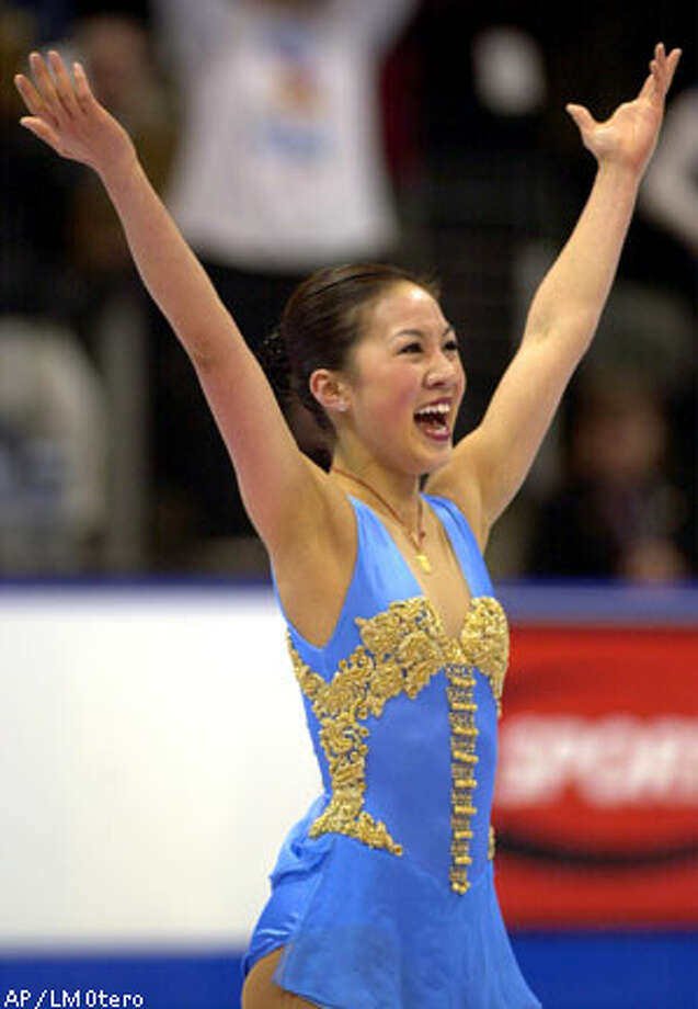 Michelle Kwan listens to wild applause after winning her seventh title at the U.S. Figure Skating nationals. Associated Press photo by LM Otero