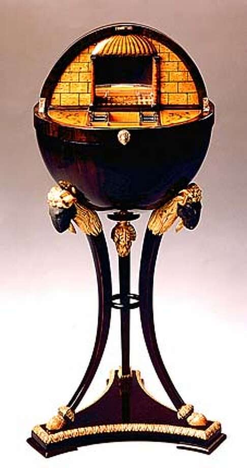 Bucheit Globe: Biedermeier globe-shaped work table, Vienna, c.1815; Ebonized maple veneer with verde antico and gilt ram heads, hooves and detail Interior: Birds-eye maple and maple veneer with partly ebonized detail and penwork decoration; H: 37'' Dia: 16.5''; from Rita Bucheit, Ltd.