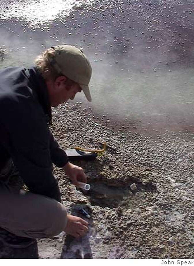 Photo of Jeff Walker sampling endolithic communities in Norris Geyser Basin. Photo by John Spear Photo: John Spear