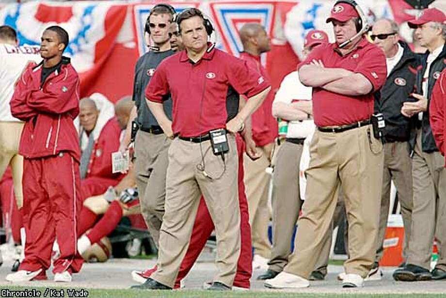 The San Francisco 49er's Steve Mariucci checks out the score board during the last few seconds of the thrid quarter of the playoff game at Raymond James Stadium, in Tampa Bay Florida Sunday January 12, 2003. SAN FRANCISCO CHRONICLE PHOTO BY KAT WADE Photo: KAT WADE