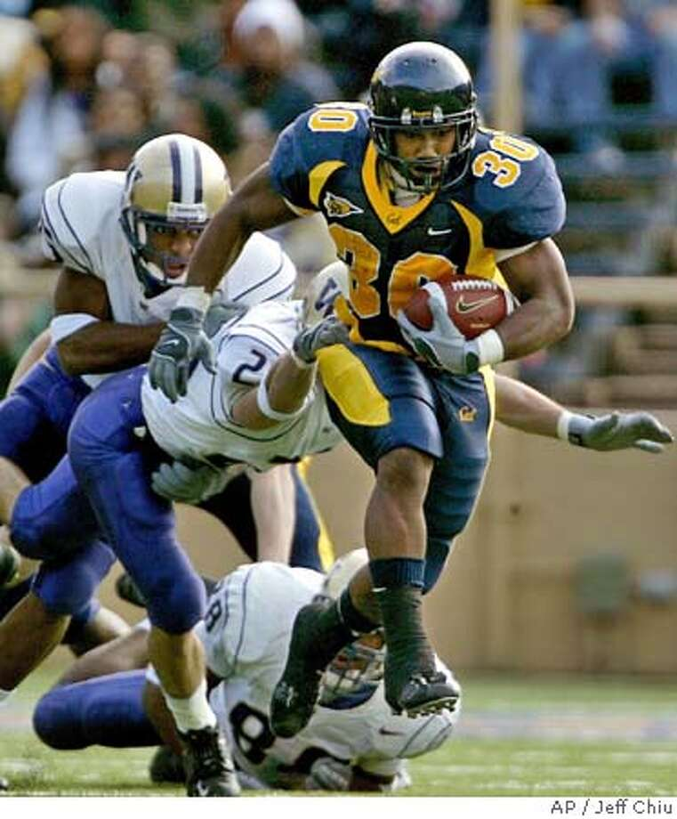 ** ADVANCE FOR THURSDAY, OCT. 21, 2004, AND THEREAFTER ** California running back J.J. Arrington, right, runs past Washington's James Sims Jr., far left, Jimmy Newell, center, and Marquis Cooper, on ground, during the second quarter of California's 54-7 victory Saturday, Nov. 15, 2003, in Berkeley, Calif. Arrington is California coach Jeff Tedford's latest running back project. (AP Photo/Jeff Chiu,file) ADVANCE FOR THURSDAY, OCT. 21, 2004, AND THEREAFTER; NOV. 15, 2003 FILE PHOTO Sports#Sports#Chronicle#10/22/2004#ALL#5star##0422423316 Photo: JEFF CHIU