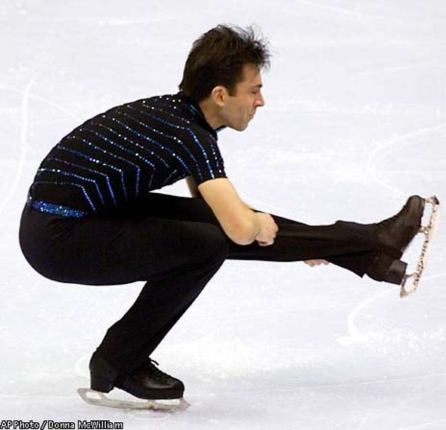 Michael Weiss, of Fairfax, Va., performs during the free skate competition at the 2003 U.S. Figure Skating Championships, Saturday, Jan. 18, 2003, in Dallas. Weiss won the event. (AP Photo / Donna McWilliam) Photo: DONNA MCWILLIAM