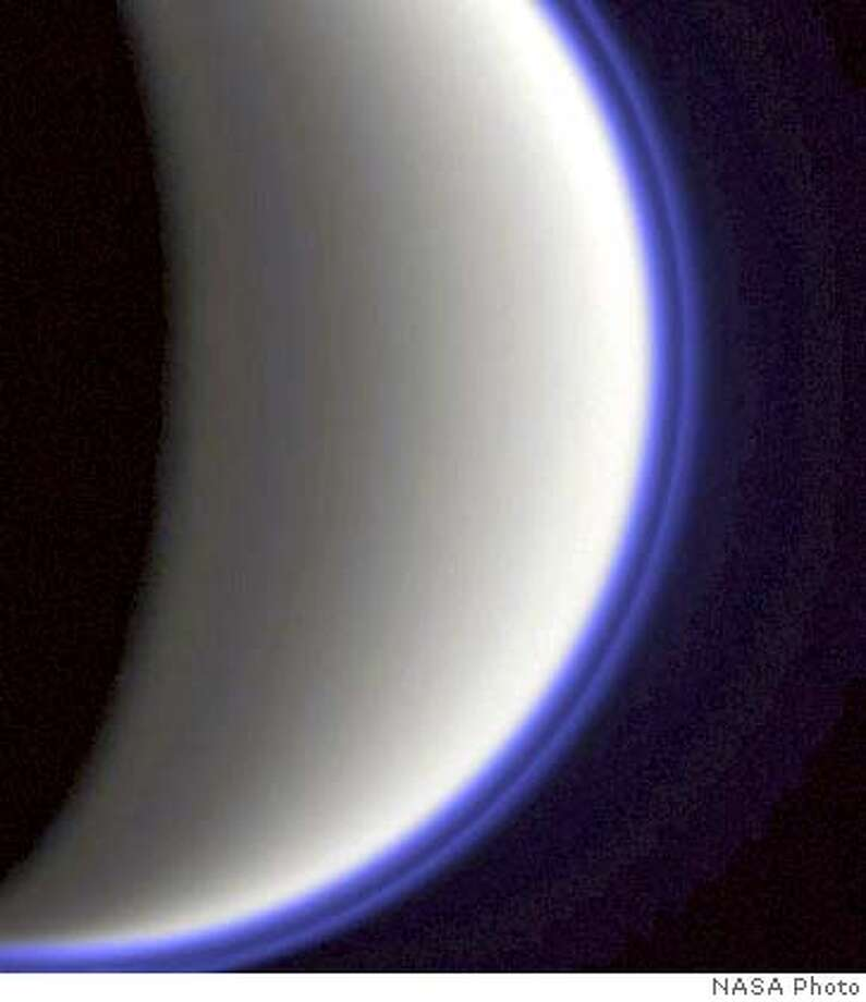 (NYT13) UNDATED -- Oct. 25, 2004 -- SCI-SATURN-MOON -- Titan, a moon of Saturn, captured in an earlier Cassini flyby. The Cassini spacecraft is on course to pass within 750 miles of Titan at 12:44 p. m. Eastern time on Tuesday. Its cameras and imaging radar system are expected to break through the moon's opaque atmosphere and for the first time map wide swaths of its hidden surface. (NASA/JPL/Space Science Institute/The New York Times) XNYZ Nation#MainNews#Chronicle#10/26/2004#ALL#5star##0422431730 Photo: NASA/JPL/Spce Science Institute