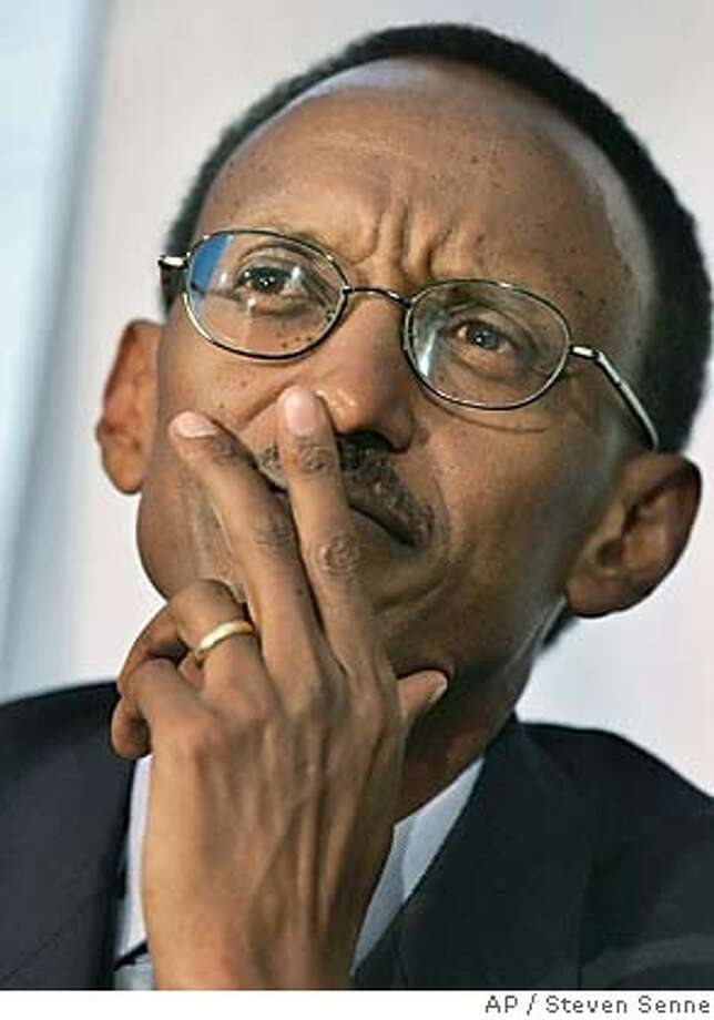 """President of Rwanda, Paul Kagame, responds to a question while facing reporters at the Statehouse, in Boston, Monday, April 11, 2005. During remarks Kagame said he hopes to move Rwanda beyond its tragic recent history by boosting development in the country, in part by luring manufacturers and """"eco-tourists."""" (AP Photo/Steven Senne) Ran on: 04-19-2005  Rwandan President Paul Kagame was awarded an honorary degree in Stockton. Photo: STEVEN SENNE"""