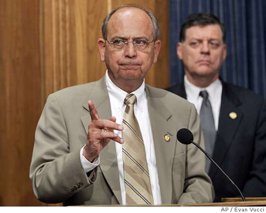 House ethics committee chairman Rep. Doc Hastings, R-Wash., gestures during a news conference on Wednesday, April 20, 2005 in Washington. Republicans on the House ethics committee said Wednesday they were ready to open an investigation into allegations of wrongdoing against Majority Leader Tom DeLay. At right is Rep. Tom Cole, R-Okla. (AP Photo/Evan Vucci) Photo: EVAN VUCCI