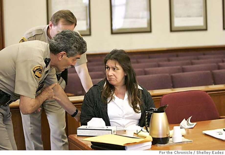 *****PLEASE DOUBLE CHECK CAPTION INFO******  Sheriff Ken Fivella reminds defendent Jimena Barreto of some court rules in a Contra Costa County court room in Martinez while on trial for a hit and run that resulted in the deaths of two children. Photo by Shelley Eades  Taken on April 18, 2005 Photo: Shelley Eades
