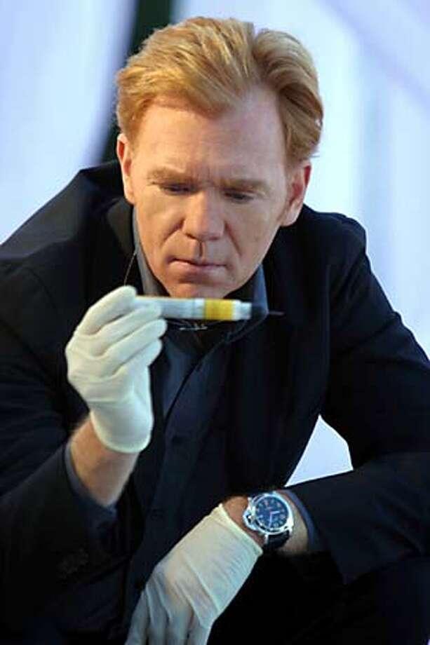 "David Caruso examines forensic evidence on ""CSI: Miami,"" the season's most popular new drama."