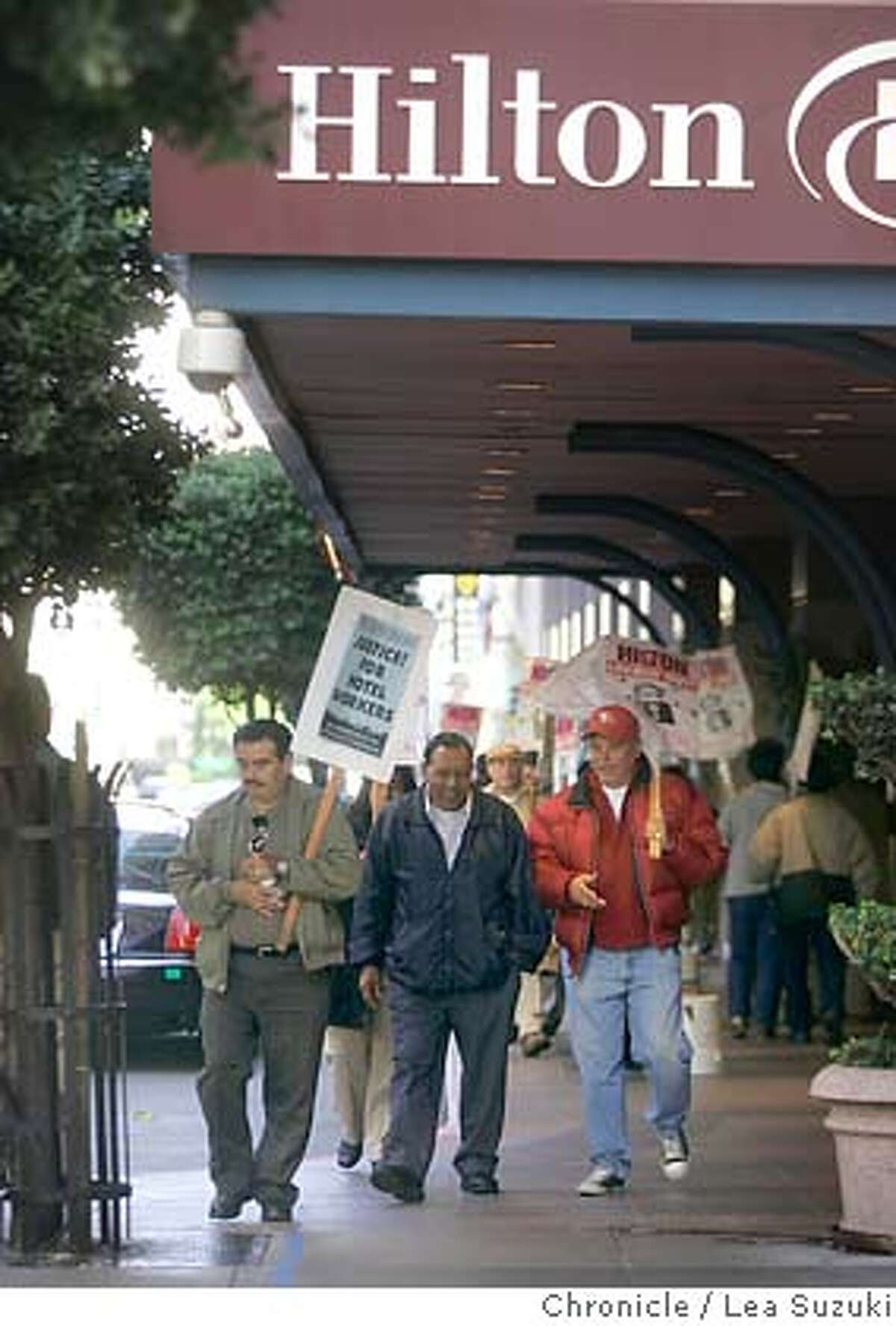hotels005_ls.jpg From left: Jose Martinez, Lazaro Via Lobos and Mario Martinez walk in front of the Hilton Hotel on O'Farrell. Hilton Hotels is suggesting to an anthropology convention to move its November gathering to a (non-union) Atlanta Hilton location for some sort of compensation if the group wants to avoid potential inconveniences created by the lock-out. We're looking for photos of locked out picketers in front of the Hilton. (WOULD ESPECIALLY LIKE TO SEE THAT THE LOCATION IS THE HILTON SINCE THAT IS A CENTRAL FOCUS OF THE STORY). City:� SF, CA Location:� Hilton Hotel O'Farrell betw Taylor and Mason Photo taken on 10/25/04 in San Francisco, CA. Lea Suzuki/ San Francisco Chronicle MANDATORY CREDIT FOR PHOTOG AND SF CHRONICLE/ -MAGS OUT Business#Business#Chronicle#10/26/2004#ALL#5star##0422431863