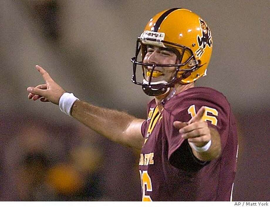 Arizona State quarterback Andrew Walter smiles after ASU scored it's fourth touchdown of the night against Iowa Saturday, Sept. 18, 2004 at Sun Devil Stadium in Tempe, Ariz. (AP Photo/Matt York) Ran on: 09-20-2004  ASU's Andrew Walter completed 31-of-43 passes for 428 yards and five touchdowns against Iowa. Sports#Sports#Chronicle#10/27/2004#ALL#5star##0422359487 Photo: MATT YORK