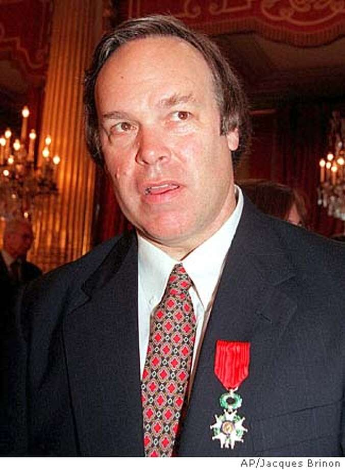 PARKER-C-08JAN03-FD-AP --- American wine critic Robert Parker after he was awarded Knight in the Legion of Honor by French President Jacques Chirac, Tuesday June 22, 1999 at the Elysee Palace in Paris. Parker, founder and editor of the bimonthly Wine Advocate newsletter, is also the author of several books on French wines.(AP PHOTO/Jacques Brinon)  ALSO RAN 03/06/03 Jancis Robinson ProductNameChronicle Jancis Robinson ProductNameArticle_NameALL.Advance.Wine_front.ART6
