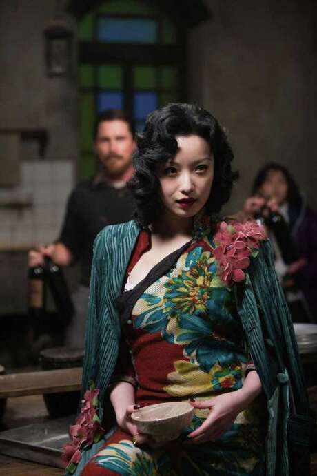 Yu Mo (Ni Ni) and a group of prostitutes take refuge in a Catholic church in Nanking following the Japanese invasion in The Flowers of War. Photo: Wrekin Hill Entertainment