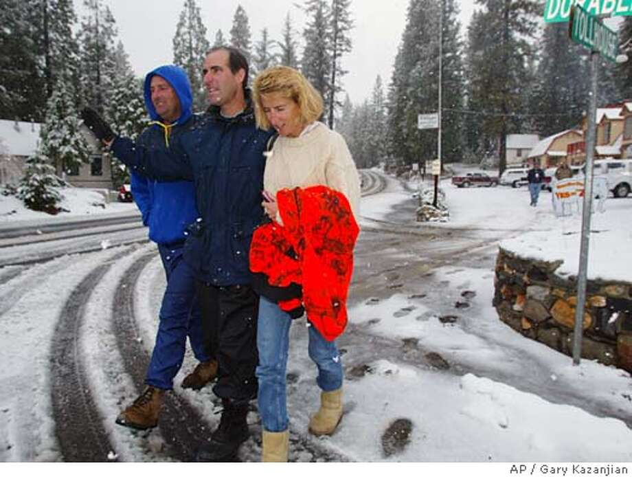 Peter, John, center, and Rita Bargetto, right, take a walk after a prayer session for family members missing in a snow storm Wednesday, Oct. 20, 2004, in Shaver Lake, Calif. Four members of the Bargetto's Santa Cruz County wine-making family have been missing since Sunday at a 9,400-foot-elevation lake east of Fresno in the Sierra National Forest. (AP Photo/Gary Kazanjian) Nation#MainNews#Chronicle#10/21/2004#ALL#5star##0422423768 Photo: GARY KAZANJIAN