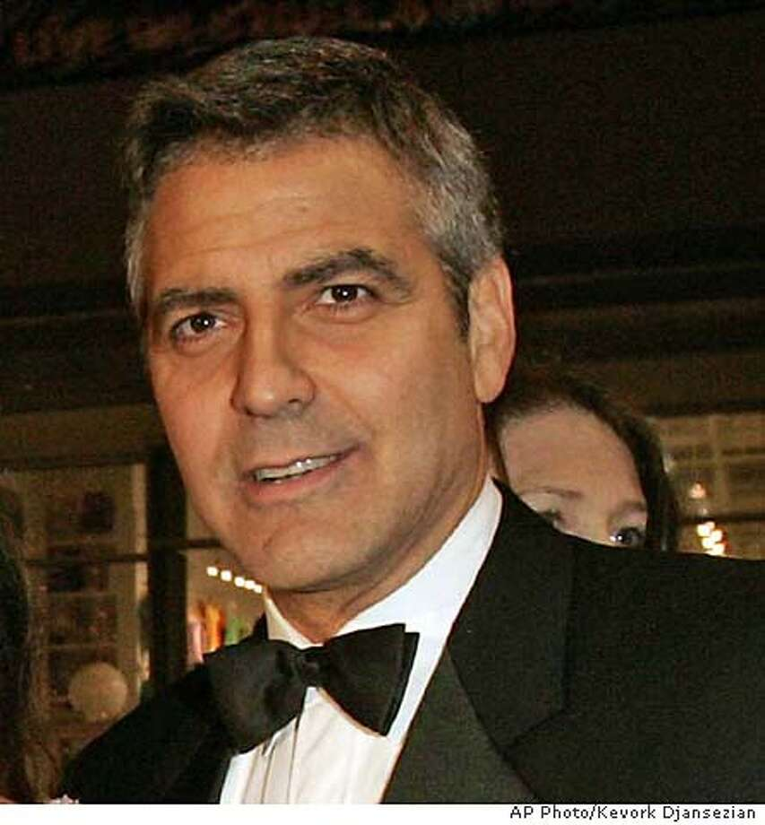 """George Clooney arrives for the premiere of """"Ocean's Twelve,"""" at the Grauman's Chinese Theatre in the Hollywood section of Los Angeles, Wednesday, Dec. 8, 2004. (AP Photo/Kevork Djansezian) Ran on: 12-15-2004  Barry Manilow A DEC 8 2004 PHOTO Photo: KEVORK DJANSEZIAN"""