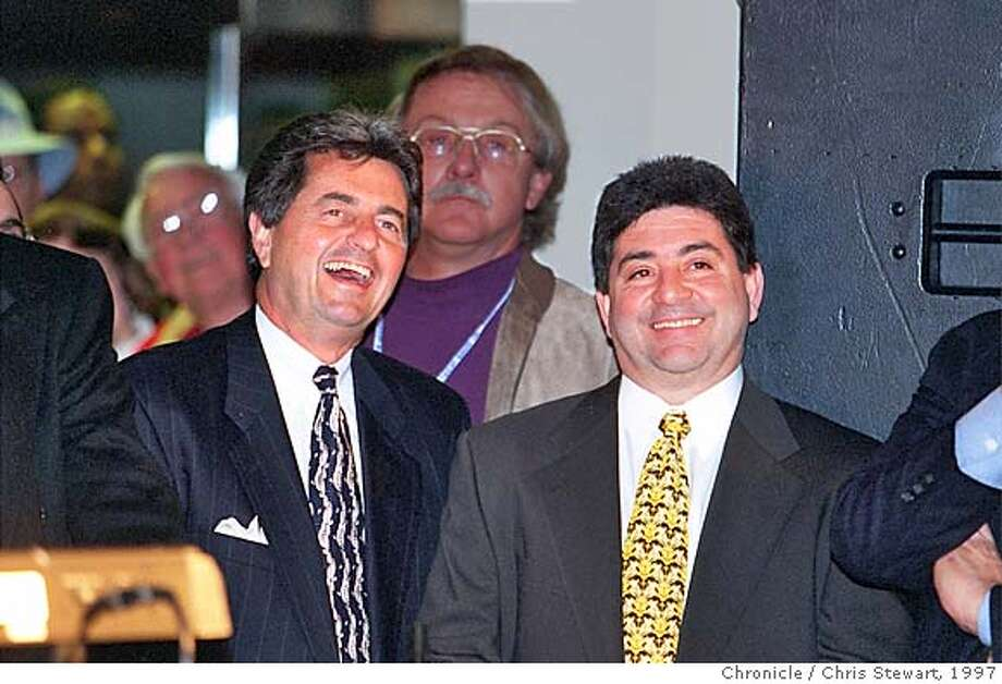 49ERS 2/C/04MAR97/CD/CS - San Francisco 49ers team president Carmen Policy (L) and owner Eddie DeBartolo smile during a rally to drum up interest in building a new 49ers stadium. SAN FRANCISCO CHRONICLE PHOTO BY CHRIS STEWART ALSO RAN: 9/4/98, 2/25/99, 3/5/999 CA Photo: CHRIS STEWART