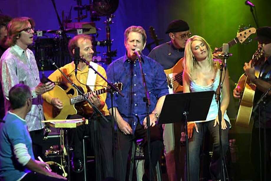 """Former member of the Beach Boys, Brian Wilson, center, sings with his band Thursday, Sept. 30, 2004, in Minneapolis, where he began a tour to showcase his album, """"Smile."""" (AP Photo/Jim Mone) STAND ALONE PHOTO Datebook#Datebook#Chronicle#10/24/2004#ALL#Advance##0422385924 Photo: JIM MONE"""