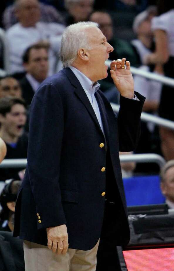 San Antonio Spurs coach Gregg Popovich yells to his players during the first half of an NBA basketball game against the Orlando Magic, Wednesday, Jan. 18, 2012, in Orlando, Fla. Photo: AP
