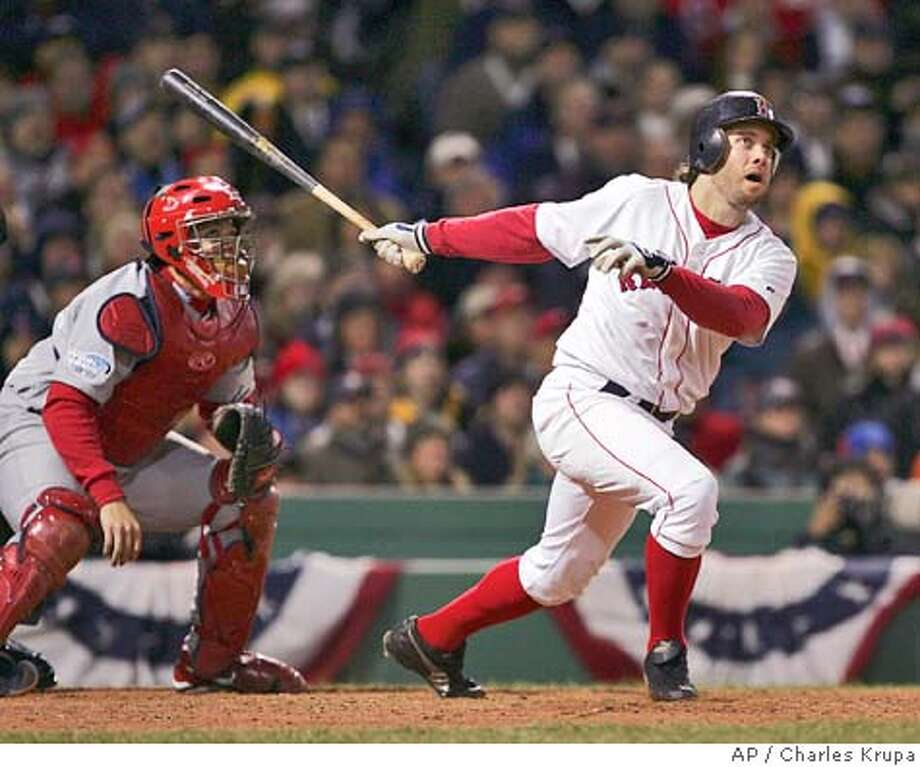 Boston Red Sox's Mark Bellhorn hits an eighth inning two-run home run off St. Louis Cardinals' Julian Tavarez in Game 1 of the World Series in Boston, Saturday, Oct. 23, 2004. (AP Photo/Charles Krupa) Photo: Charles Krupa
