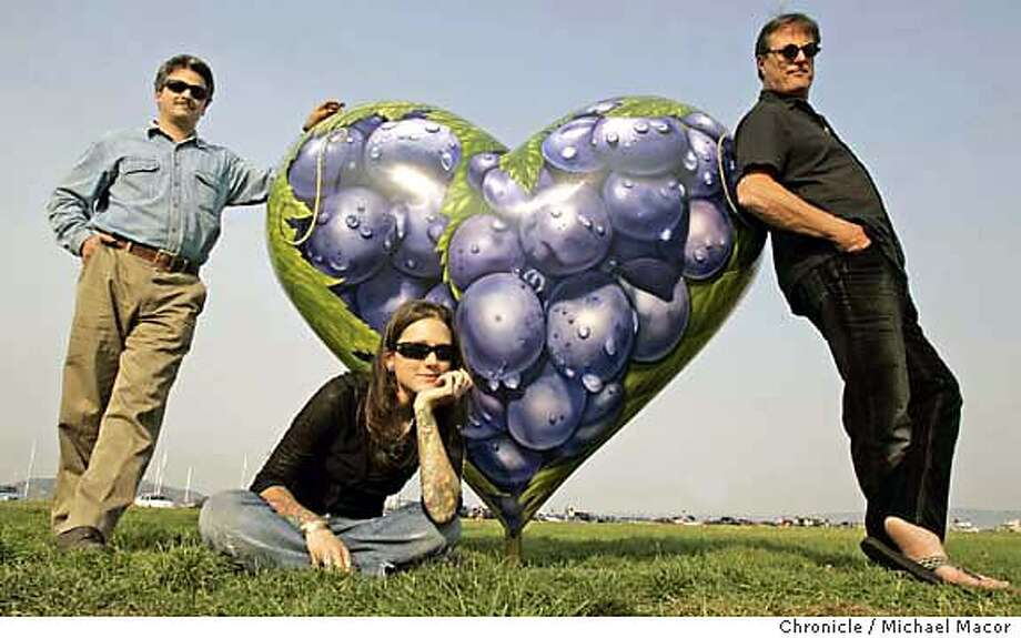 Artists, l to r- Pete Misthos, Amanda Lynn Grazier and Prairie Prince with their grape theme creation, at the corner of Bay and Scott Sts., in the Marina. Final installment of the Pink sections Heart Monitor. 10/14/04 San Francisco, CA Michael Macor / San Francisco Chronicle Mandatory Credit for Photographer and San Francisco Chronicle/ - Magazine Out Datebook#Datebook#SundayDateBook#10-24-2004#ALL#Advance##0422413757 Photo: Michael Macor