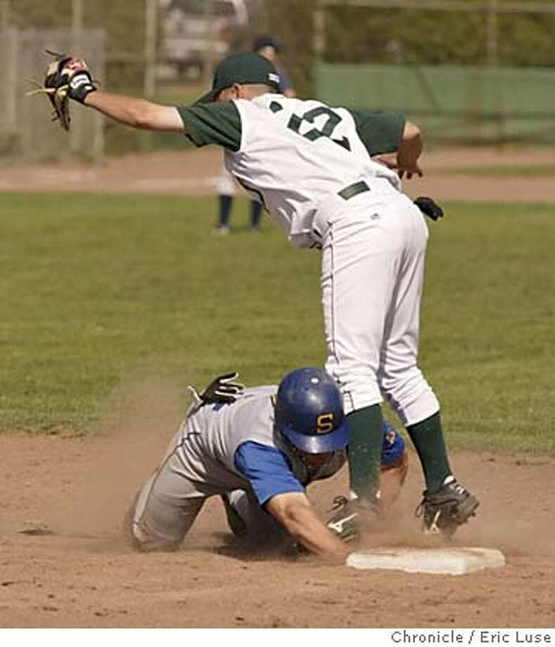 WCAL13_0068_el.JPG  #7 Junipero Sierra Doug Hansen dives for 2nd during a pick off attempt by #22 Sacred Heart Eric Herrera High school baseball. Serra vs. Sacred Heart Cathedral at Moscone Field Event on 4/12/05 in San Francisco. Eric Luse / The Chronicle MANDATORY CREDIT FOR PHOTOG AND SF CHRONICLE/ -MAGS OUT Photo: Eric Luse