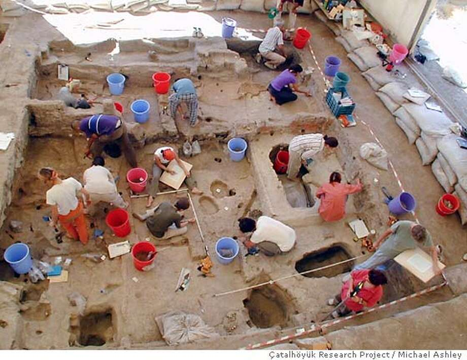 A ladder overview photo - shot by Michael Ashley Ran on: 04-18-2005  The seated woman, left, was unearthed more than 40 years ago and is 6� inches high. The badly eroded 3-inch female figurine made of limestone, right, was found last excavation season. Photo: Michael Ashley