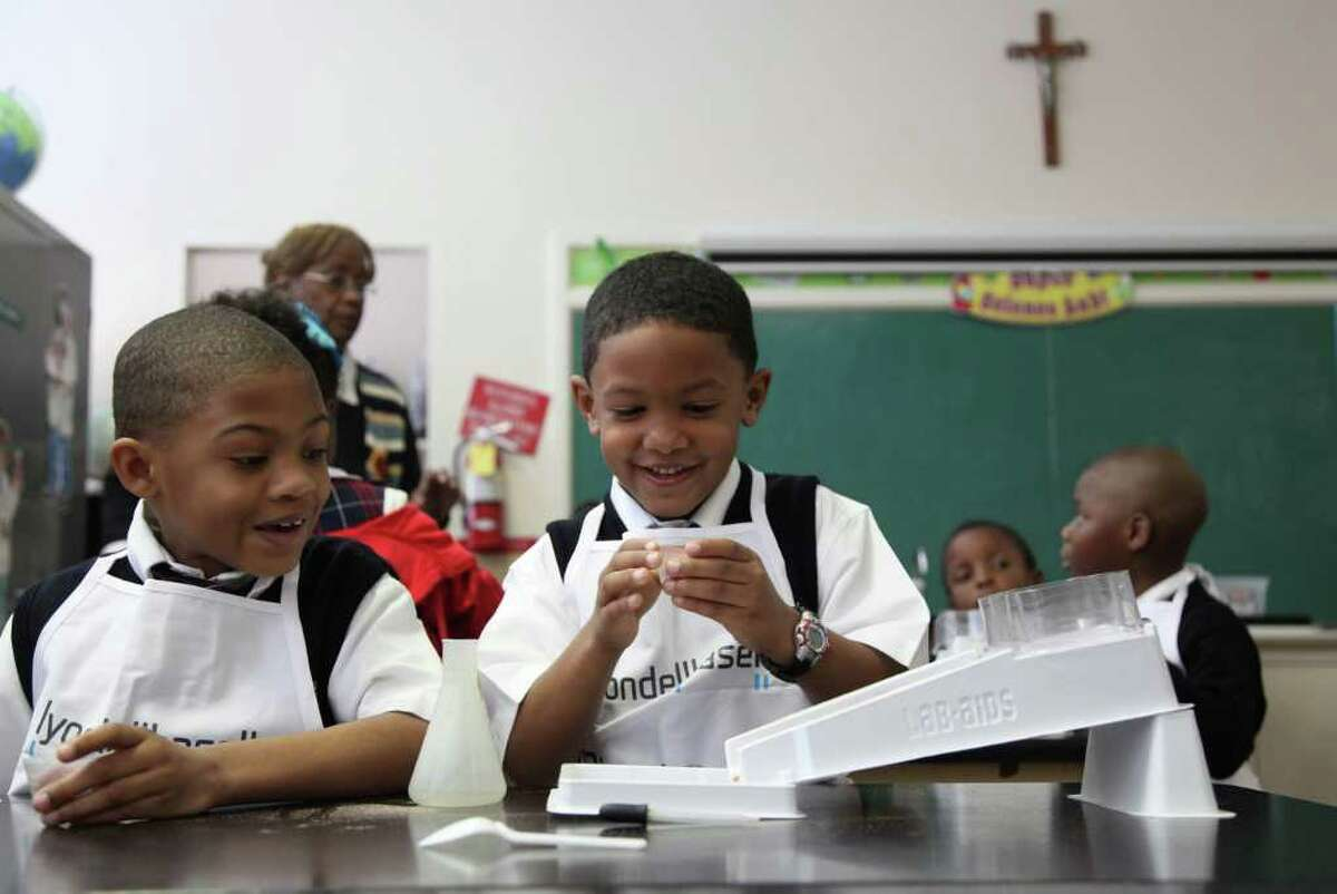 First graders Edward Joseph III and Aaden Benjamin complete a soil erosion science lab at St. Peter the Apostle Catholic School. Locally, the Archdiocese of Galveston-Houston reports that 100 percent of students educated at inner-city Catholic schools go on to high school.