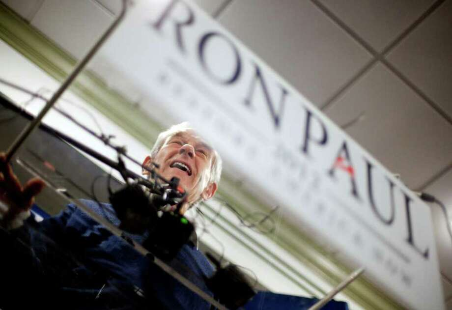 American Muslims lean Democratic -as many as 70 percent in a survey released last year by the Pew Forum - but many are supporting Republican presidential candidate Rep. Ron Paul, R-Texas. Photo: David Goldman / AP