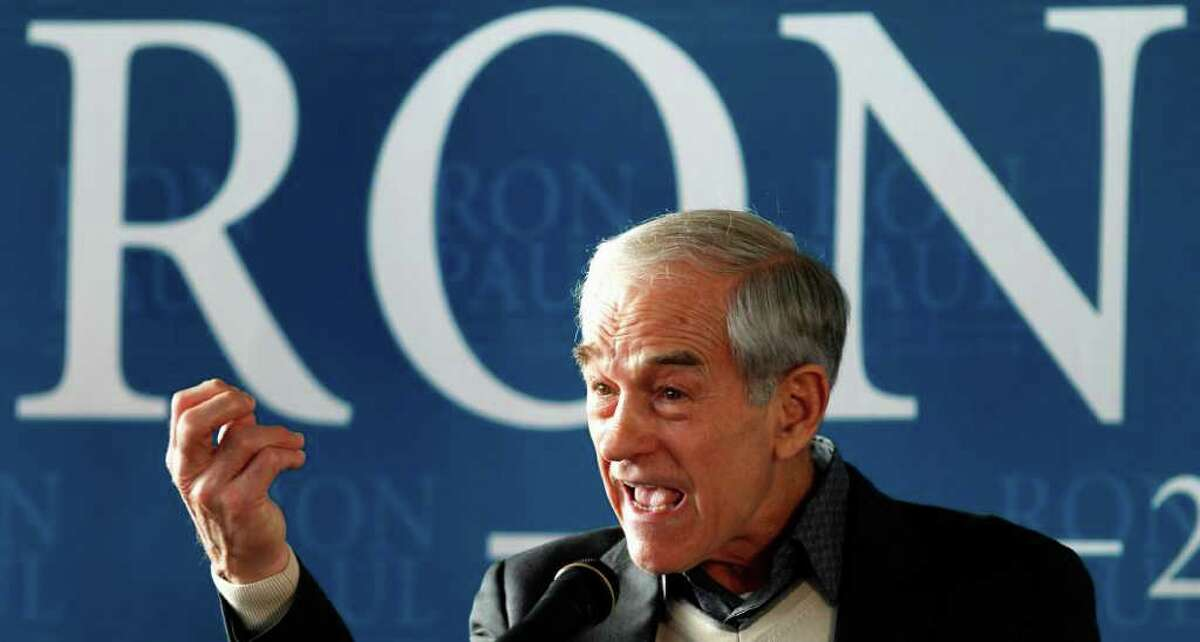 Republican presidential candidate, Rep. Ron Paul, R-Texas gestures during a campaign rally in Nashua, N.H., Friday Jan. 6, 2012. (AP Photo/Charles Krupa)