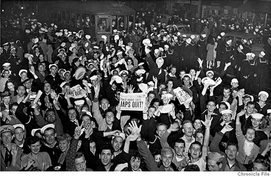 VJDAY2-B-1945-MN-CHRONICLE - Crowds on Market Street celbrating V-J Day (Victory Over Japan) during World War II, 1945. Photo by Chronicle Photo: Staff