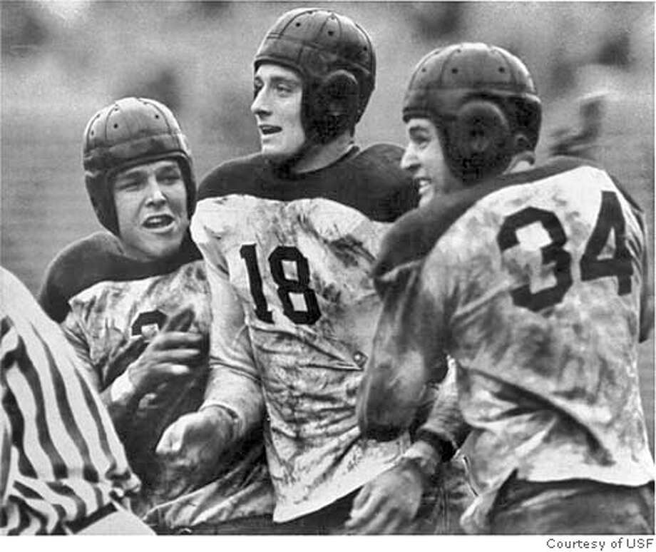 """From left, Danny Fisk, Bell Telesmanic and Dante Benedetti of USF celebrate scoring a touchdown against St. Marys on October 23, 1938. - """"Joy that Died"""" photograph. Barney Peterson/San Francisco Chronicle Sports#Sports#Chronicle#10/25/2004#ALL#5star##0422427277 Photo: Courtesy Of USF"""
