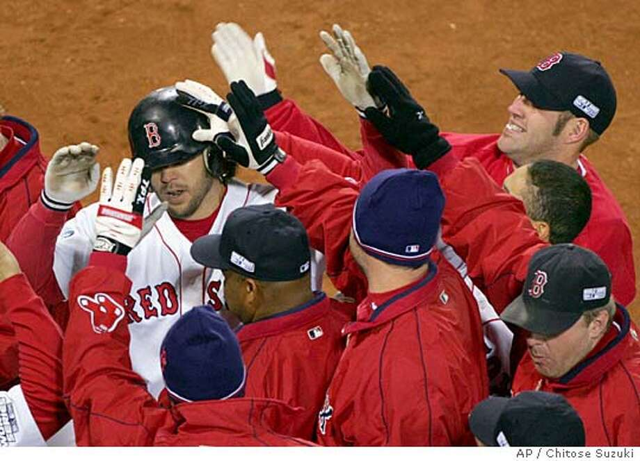 Boston Red Sox teammates mob Mark Bellhorn, left, after his 8th -inning, two-run home run against the St. Louis Cardinals in game one of the World Series in Boston, Saturday, Oct. 23, 2004. (AP Photo/Chitose Suzuki) Ran on: 10-24-2004  Mark Bellhorn is mobbed by teammates after hitting a two-run homer in the eighth off Pesky's Pole. Ran on: 10-24-2004  Mark Bellhorn is mobbed by teammates after hitting a two-run homer in the eighth off Pesky's Pole. Photo: CHITOSE SUZUKI