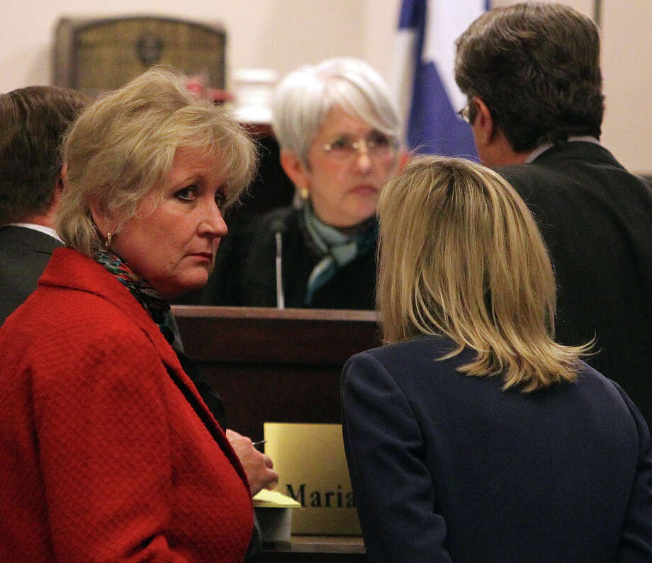 Bexar County District Attorney Susan Reed (second from left) is personally overseeing the trial of Sandra Briggs who is charged with intoxication manslaughter on Thursday, Jan. 19, 2012. Briggs was charged after hitting and killing San Antonio Police officer Sergio Antillon along Loop 410 in October 2010. She was suspected of being drunk at the time of the incident. Court was adjourned for the day while Briggs took the stand to testify. The trial continues on Friday. Kin Man Hui/San Antonio Express-News Photo: Kin Man Hui, SAN ANTONIO EXPRESS-NEWS / San Antonio Express-News
