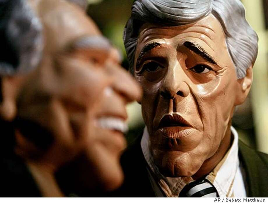 Actors perform wearing the new Democratic presidential candidate Sen. John Kerry, D-Mass., Halloween mask, right, and a President Bush mask during a press preview at the Abracadabra store in New York, Wednesday Oct. 6, 2004. (AP Photo/Bebeto Matthews) STAND ALONE Insight#Insight#Chronicle#10/24/2004##Advance##0422398467 Photo: BEBETO MATTHEWS