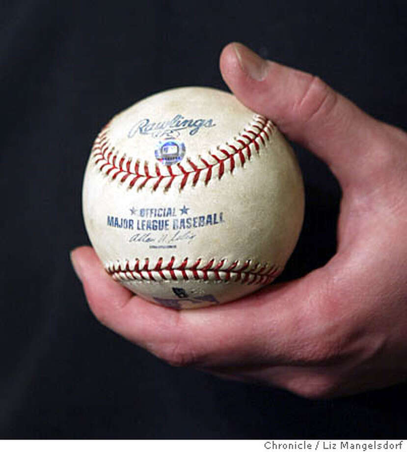 Event on 9/17/04 in San Francisco.  Steven Williams, 25, of Pacifica(not pictured) holds bond's 700th homerun ball. This is during a press conference. Barry Bonds hits his 700th home run against the Padres in the 3rd inning. Liz Mangelsdorf / The Chronicle Photo: Liz Mangelsdorf