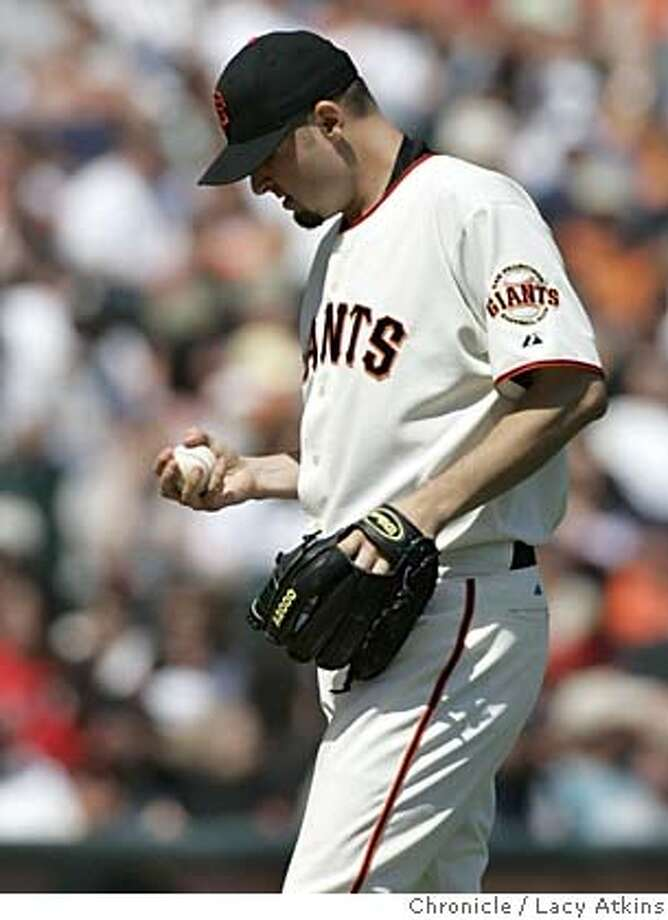San Francisco Giants starting and winning pitcher of the day Jason Schmidt contemplates his next pitch against the Colorado Rockies, April 10, 2005. San Francisco Giants beat the Colorado 11 to 4 at SBC Park Sunday April 10, 2005, in San Francisco.  Photographer Lacy Atkins Photo: LACY ATKINS