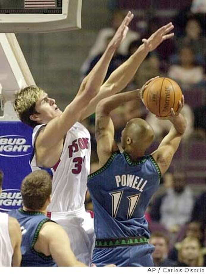 Detroit Pistons center Darko Milicic, center, of Serbia-Montenegro, goes up to deflect a shot by Minnesota Timberwolves forward Kasib Powell (11) during the second quarter Sunday, Oct. 17, 2004, at the Palace in Auburn HIlls, Mich. (AP Photo/Carlos Osorio) Sports#Sports#Chronicle#10/24/2004#ALL#2star##0422418497 Photo: CARLOS OSORIO