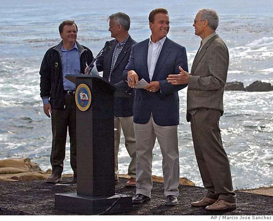 California Governor Arnold Schwarzenegger, second from right, is joined by , from left, State EPA secretary Terry Tamminen, Resource Agency Director, Mike Christman and actor Clint Eastwood, in announcing an ocean protection plan at Point Lobos State Park near Carmel, Calif. on Monday, Oct. 18, 2004. (AP Photo/Marcio Jose Sanchez) Photo: MARCIO JOSE SANCHEZ