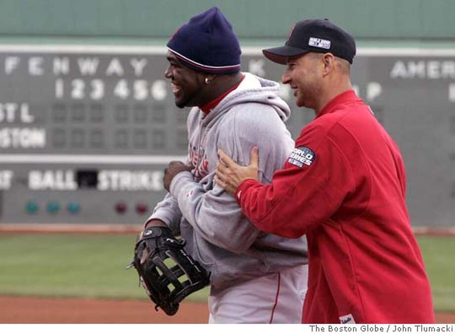(NYT24) BOSTON -- Oct. 22, 2004 -- BBO-WORLD-SERIES-4 -- Boston Red Sox manager Terry Rancona, right, and David Ortiz, the American League Championship Series MVP, enjoy a laugh, Friday, Oct. 22, 2004, as the Red Sox warmed up for Saturday's Game 1 of the World Series at Fenway. They are set to play the National League Champion St. Louis Cardinals. (John Tlumacki/The Boston Globe) XNYZ Sports#Sports#Chronicle#10/23/2004#ALL#5star##0422427110 Photo: John Tlumacki