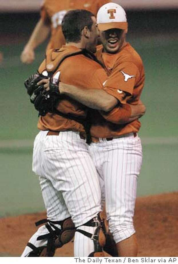 Texas pitcher Adrian Alaniz, right, is hugged by catcher Taylor Teagarden after throwing a no-hitter against Oklahoma, Saturday, April 16, 2005, at Disch-Faulk Field in Austin, Texas. Texas won 4-0. (AP Photo/The Daily Texan, Ben Sklar) Photo: BEN SKLAR